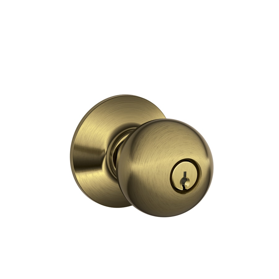 Shop schlage f orbit antique brass round keyed entry door for Exterior door knobs