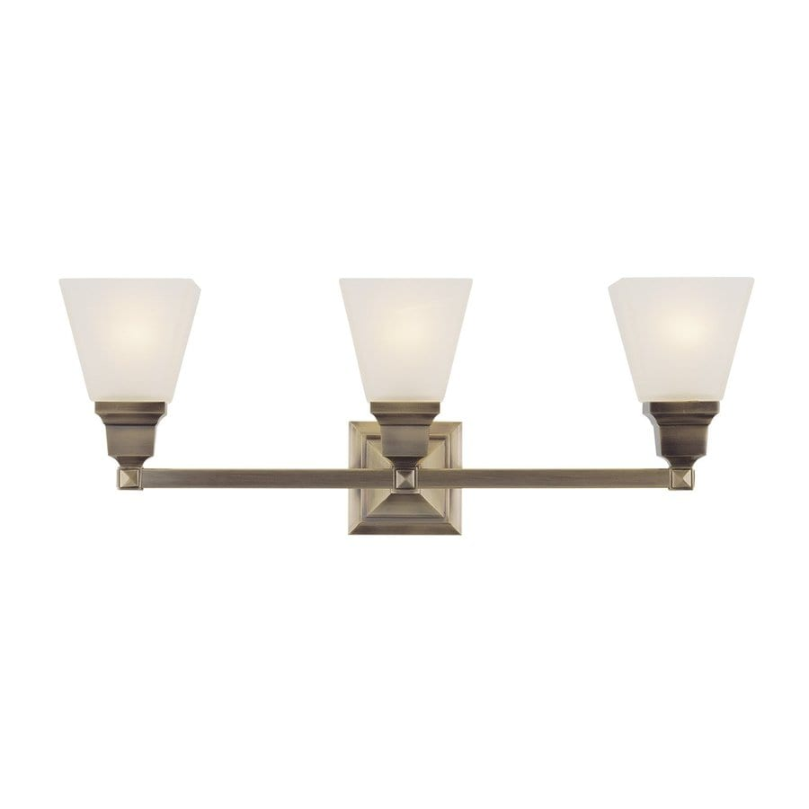 Shop livex lighting 3 light mission antique brass bathroom for Vintage bathroom vanity lights
