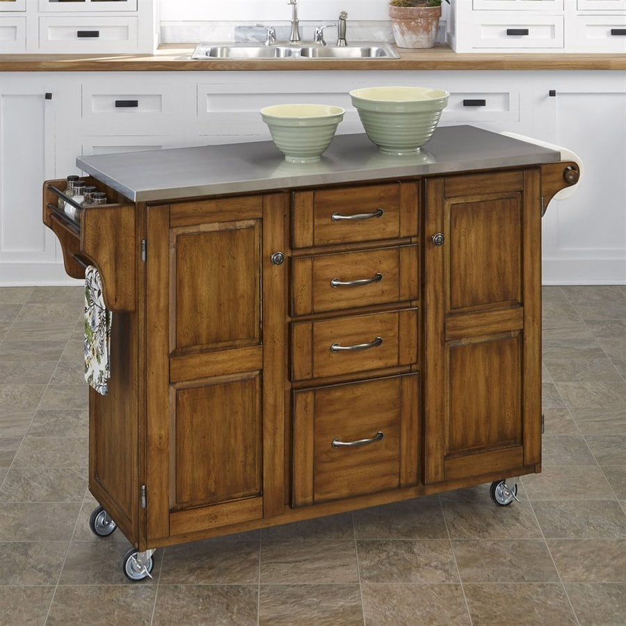Home Styles 52.5-in L x 18-in W x 35.75-in H Cottage Oak Kitchen Island Casters