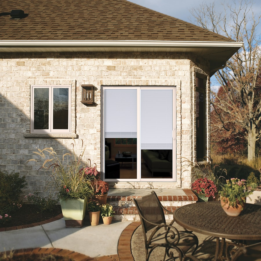 JELD-WEN 59.5-in Blinds Between the Glass White Vinyl Sliding Patio Door with Screen