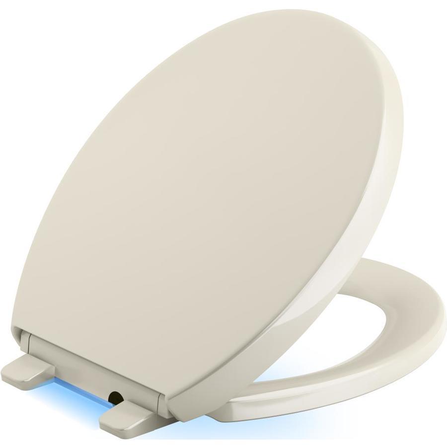 KOHLER Reveal Almond Plastic Round Slow-Close Toilet Seat