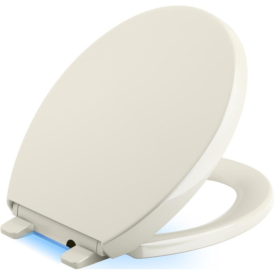 KOHLER Reveal Biscuit Plastic Round Slow-Close Toilet Seat