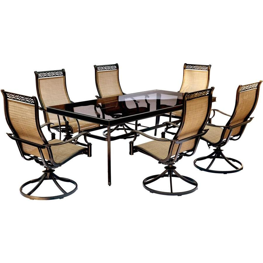Hanover monaco 7 piece patio dining set with six sling back swivel rockers and one extra large glass top dining table