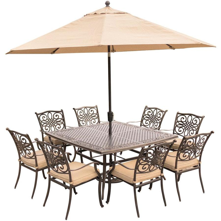Hanover traditions 9 piece dining set in tan with square 60 in cast top dining table 11 ft table umbrella and umbrella base