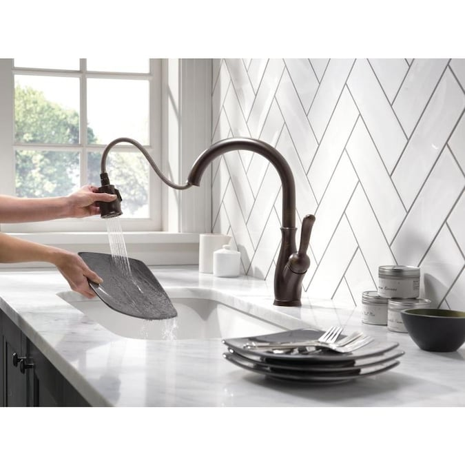 Delta Leland Venetian Bronze 1 Handle Deck Mount Pull Down Handle Kitchen Faucet Deck Plate Included In The Kitchen Faucets Department At Lowes Com