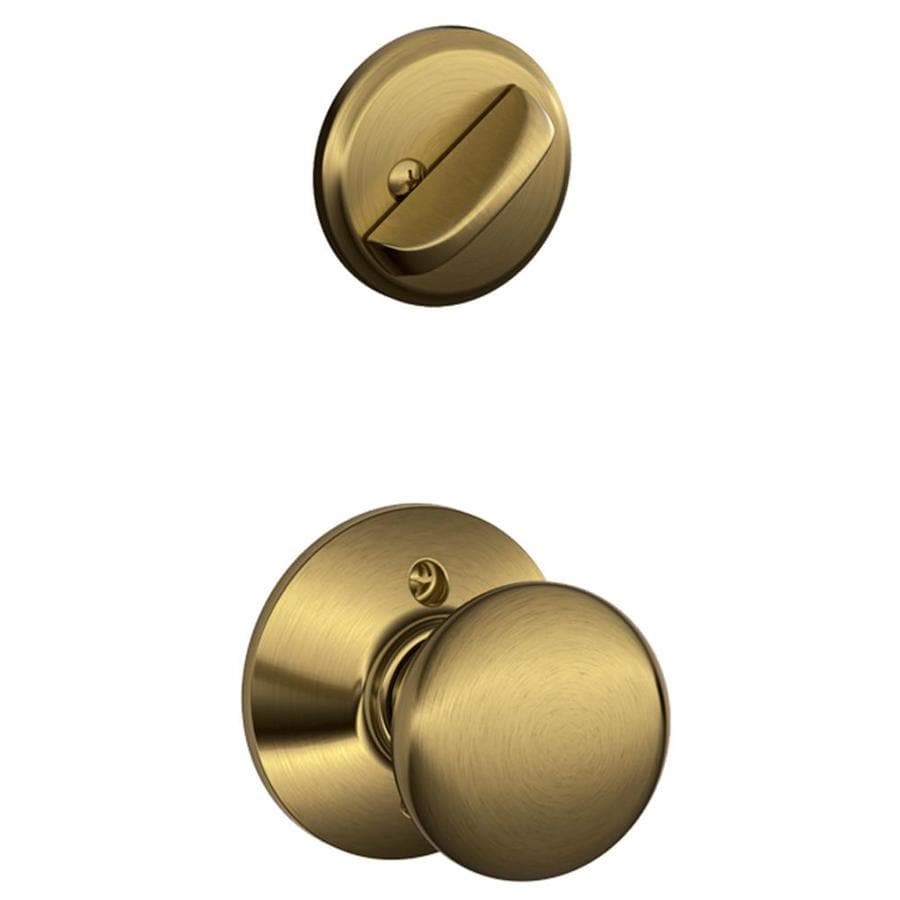 Schlage Plymouth 1-5/8-in to 1-3/4-in Antique Brass Single Cylinder Knob Entry Door Interior Handle