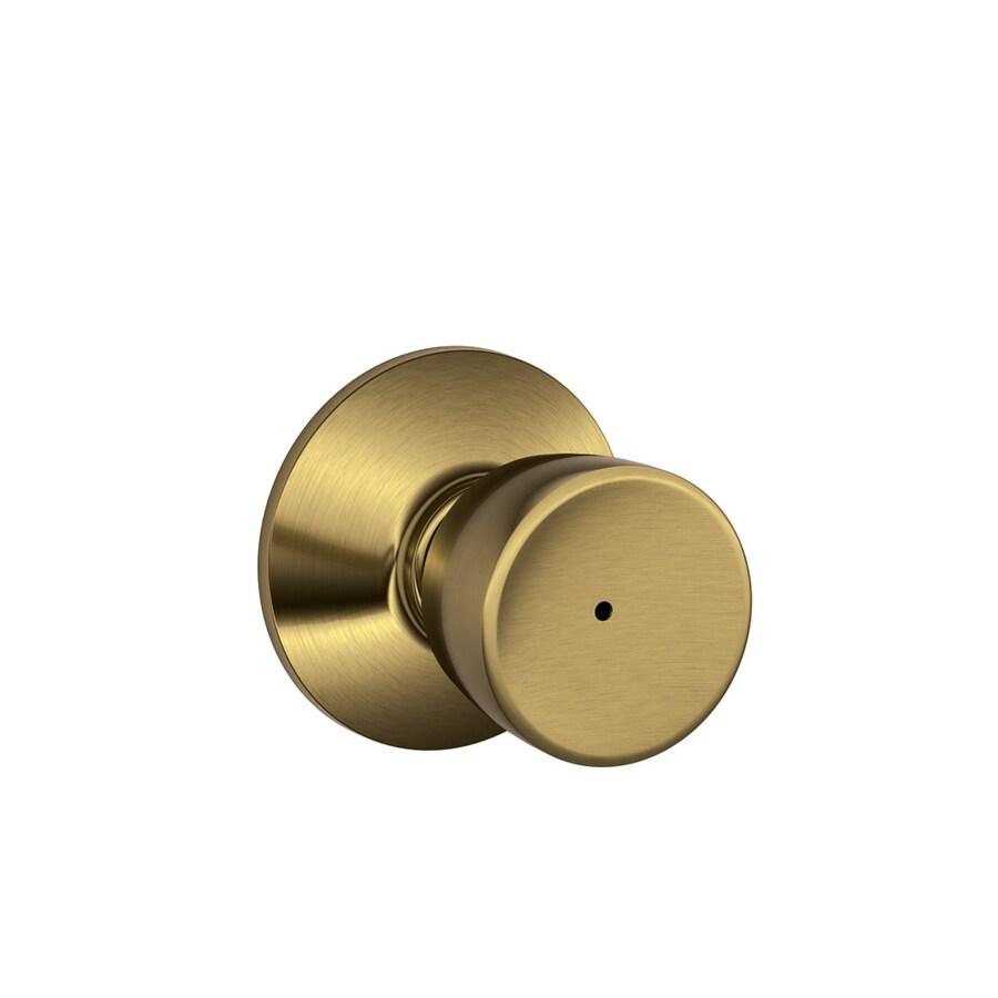 Shop Schlage F Bell Antique Brass Round Push Button-Lock Privacy ...