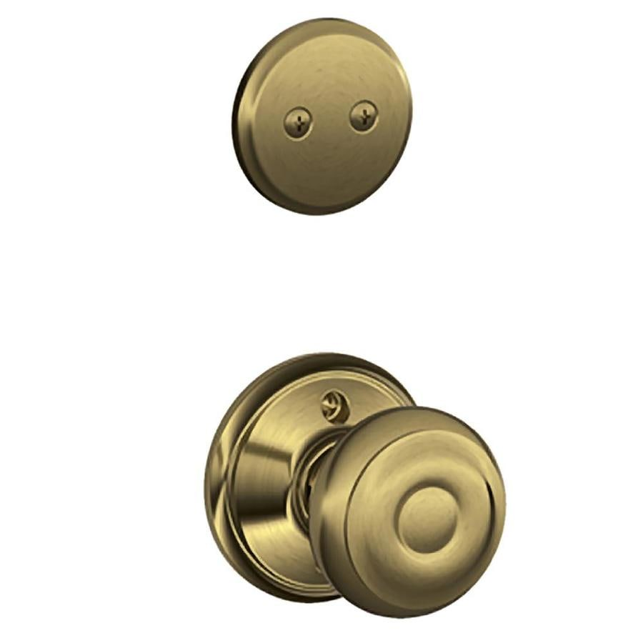 Schlage Georgian 1-5/8-in to 1-3/4-in Antique Brass Non-Keyed Knob Entry Door Interior Handle