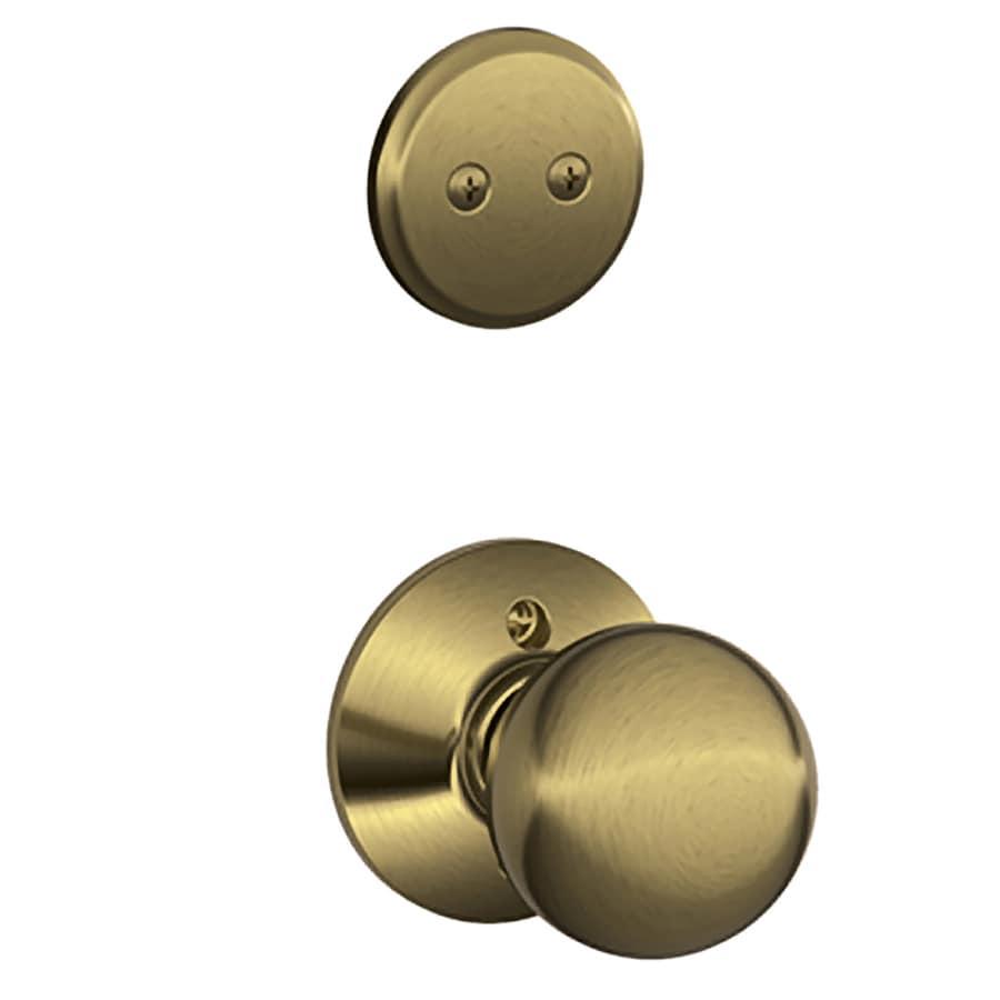 Schlage Orbit 1-5/8-in to 1-3/4-in Antique Brass Non-Keyed Knob Entry Door Interior Handle