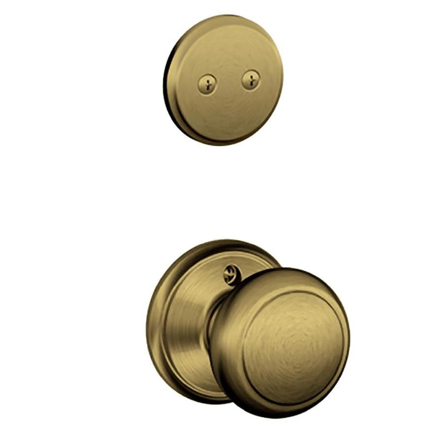 Schlage Andover 1-5/8-in to 1-3/4-in Antique Brass Non-Keyed Knob Entry Door Interior Handle