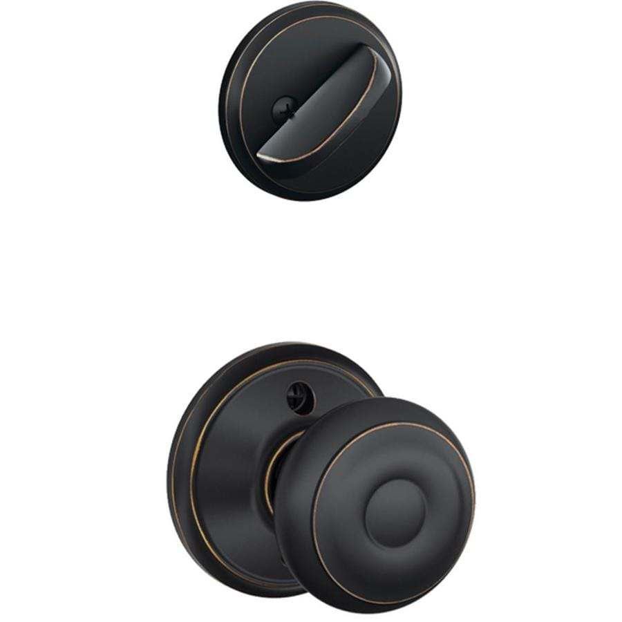 Shop schlage georgian 1 5 8 in to 1 3 4 in aged bronze for Exterior door knobs