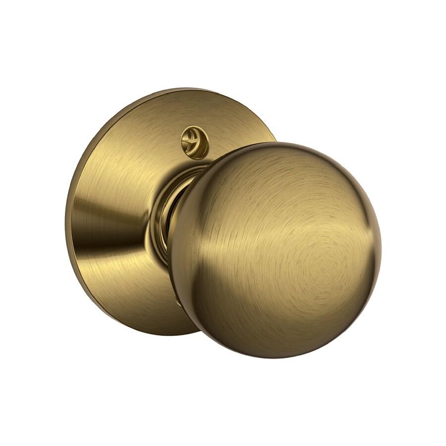 Schlage F Orbit Antique Brass Dummy Door Knob