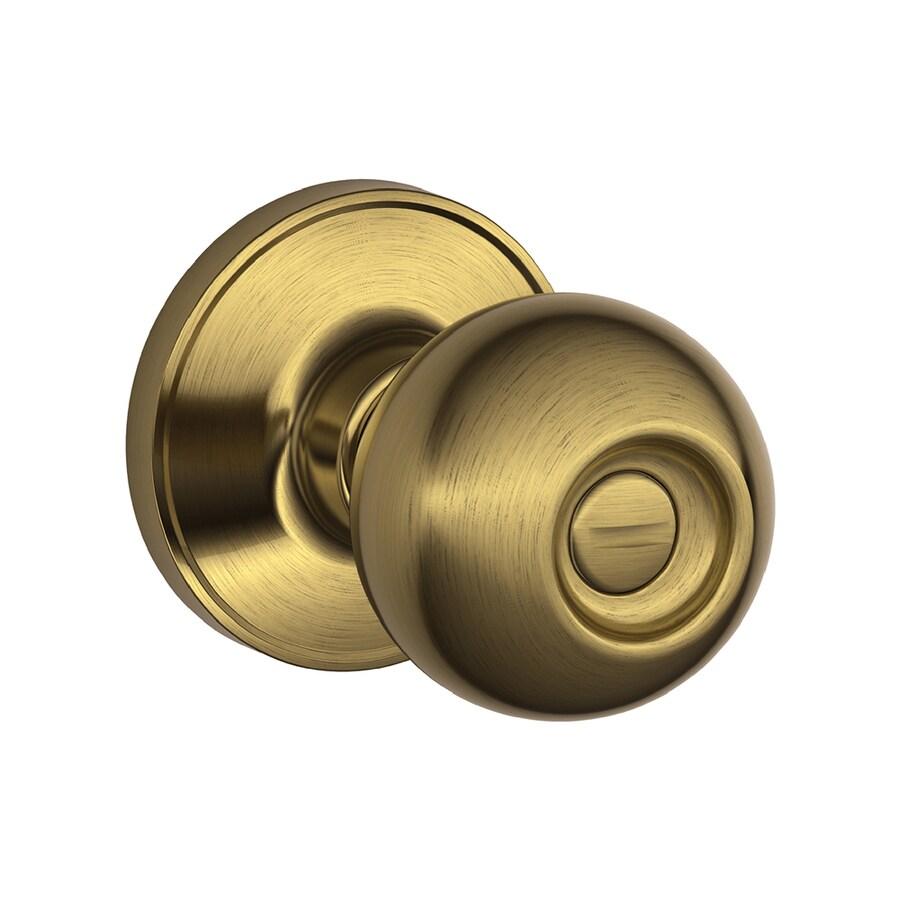 Schlage J Corona Antique Brass Round Turn-Lock Privacy Door Knob - Shop Schlage J Corona Antique Brass Round Turn-Lock Privacy Door