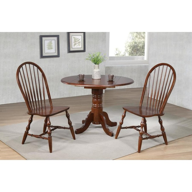 Sunset Trading Andrews Distressed Chestnut Dining Room Set With Round Table In The Dining Room