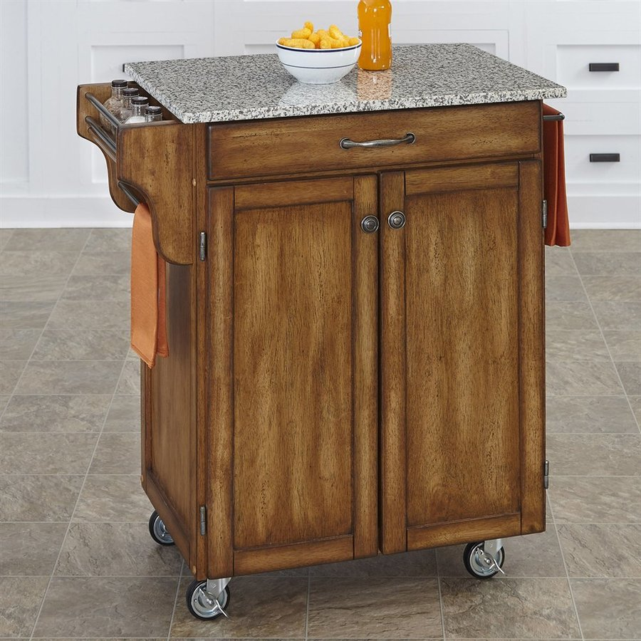 Home Styles 32.5-in L x 18.75-in W x 35.5-in H Cottage Oak Kitchen Island Casters