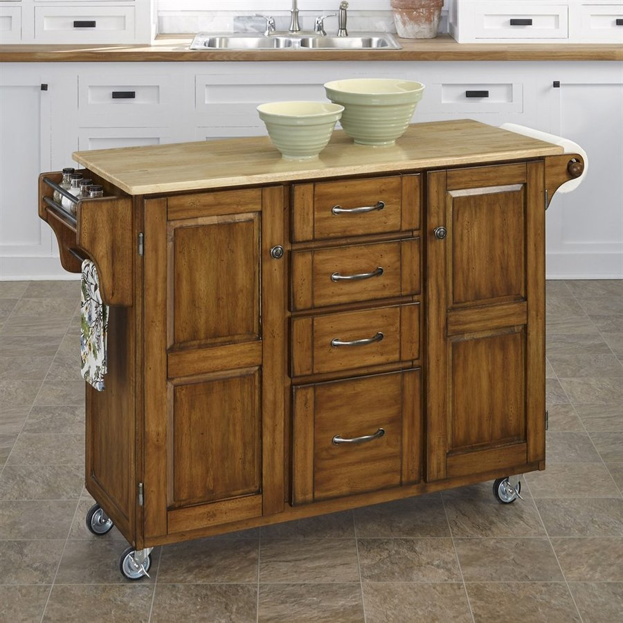 kitchen islands on casters shop home styles 52 5 in l x 18 in w x 35 75 in h cottage oak kitchen island casters at lowes com 2274