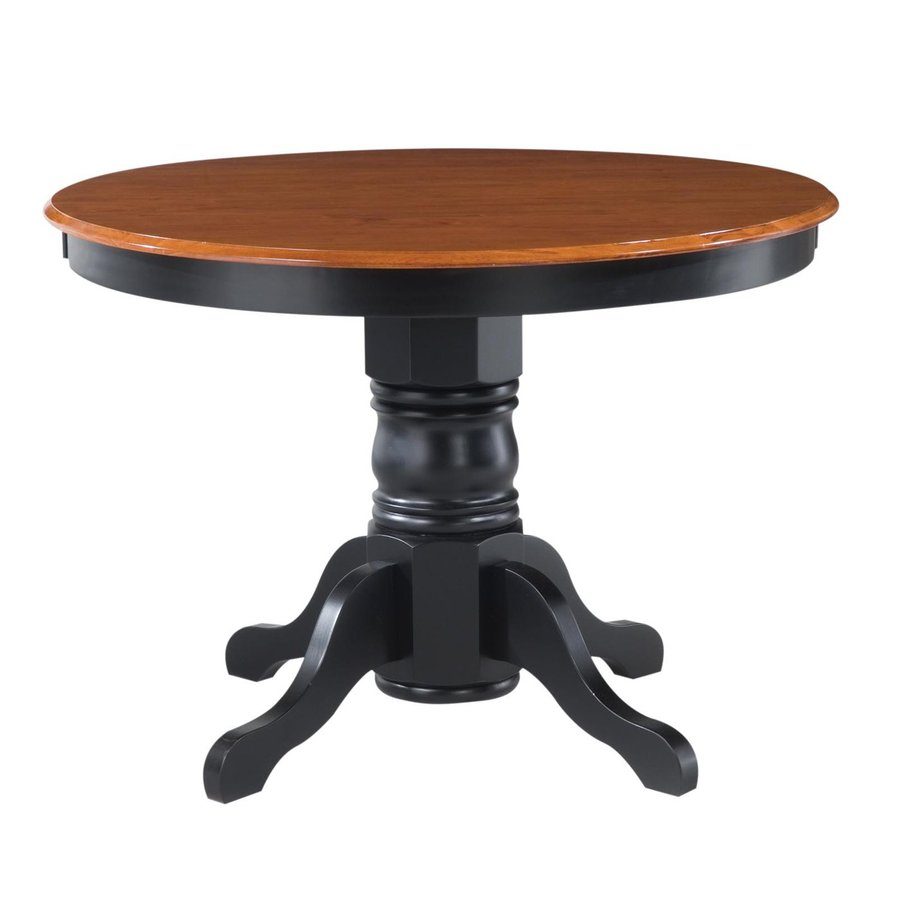 Shop home styles wood round dining table at for Shop dining tables