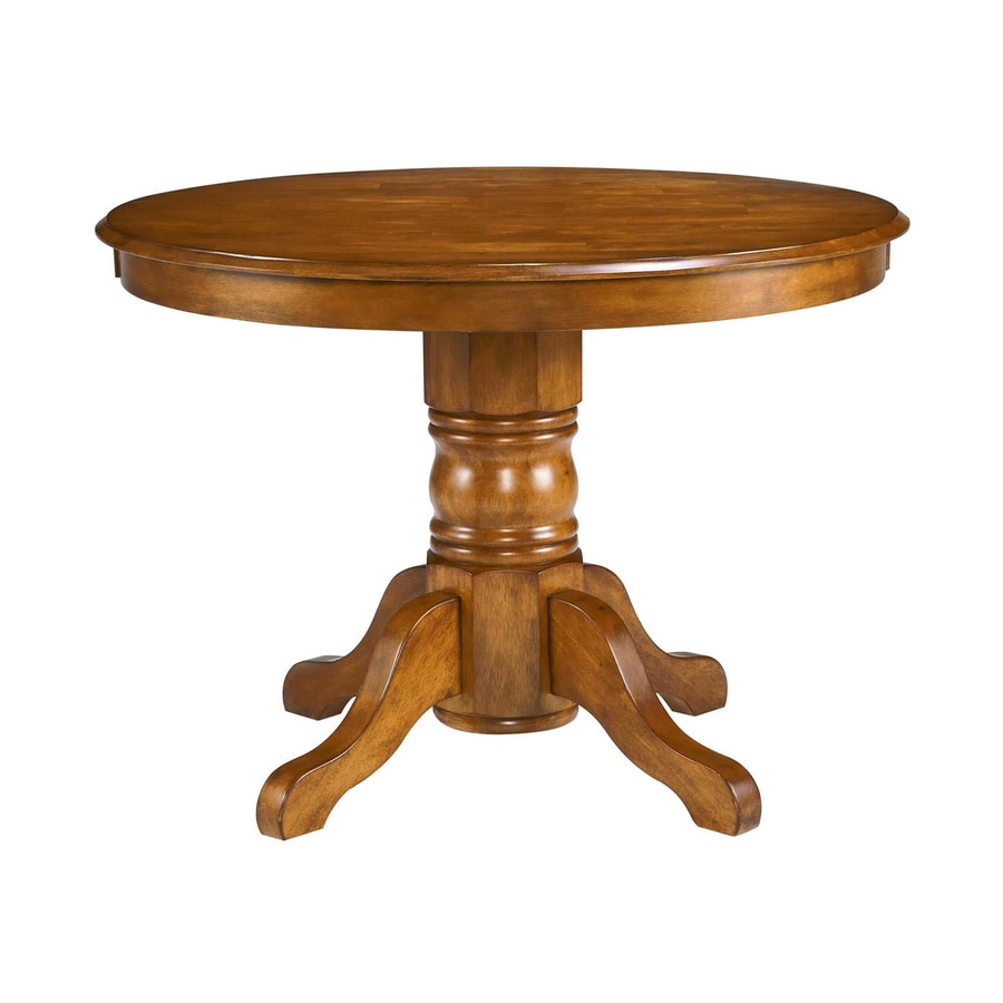 Shop home styles cottage oak wood round dining table at for Dinner table wood