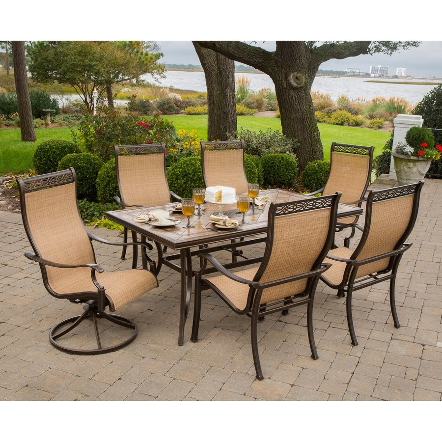 Shop hanover outdoor furniture monaco 7 piece tan metal for Metal patio table and chairs set