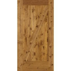 Shop interior doors at lowes simpson brown z frame solid core knotty alder wood barn door common 42 planetlyrics Image collections