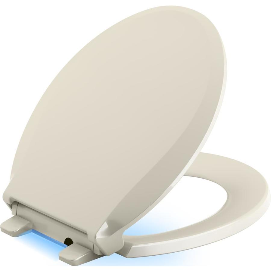 KOHLER Cachet Nightlight Almond Plastic Round Slow-Close Toilet Seat